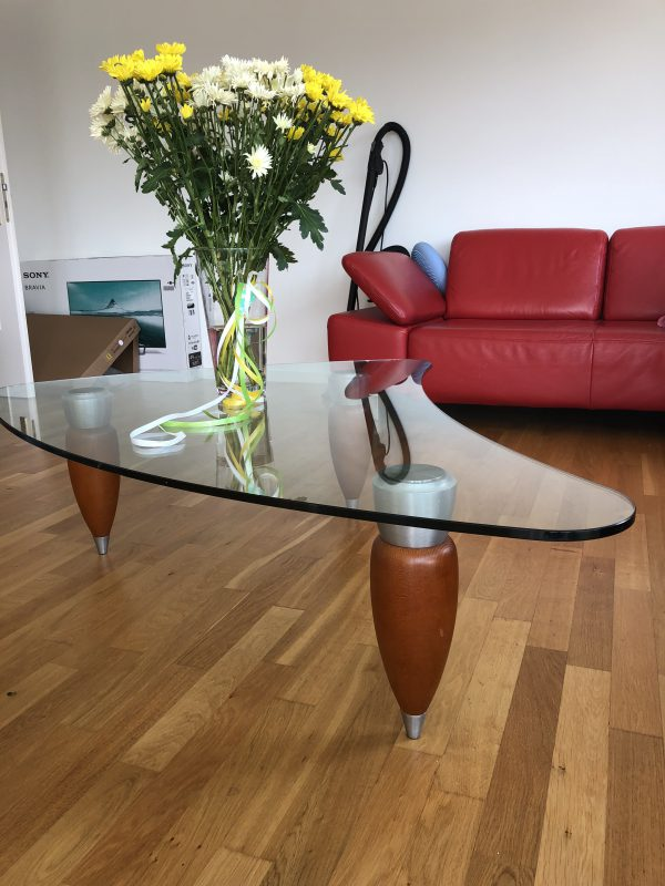 Design glass table which can be used as a couch table